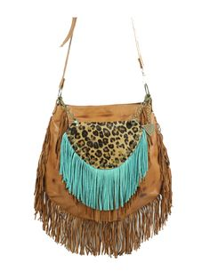 Fringed Leather Handbag - Lapwing Leathers. Finished terracotta leather and fringes in same color and removable, decorative tassel in calf skin leather with hair. Free shipping on U.S Orders. No Risk Money Back. Buy Now!
