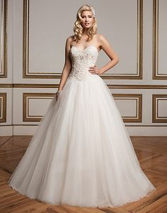 Sweetheart neckline ball gown with intricately beaded bodice, basque waist…