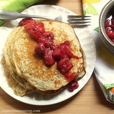 Quinoa pancakes with the flavor of lemon and poppy seeds, topped with sweet roasted strawberries.