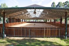 This is a picture of a riding arena on a WAIKII EQUESTRIAN ranch that is for sale. However....it is a great example of what I am looking for in an enclosed riding arena.