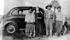 Deaconess Bedell and Miccosukee Indians standing by a car
