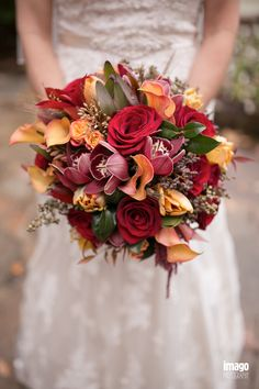 Calla lilies, orchids and roses.  Fall bouquet.  Flowers by Tami McAllister | Photo by Tim Ivey