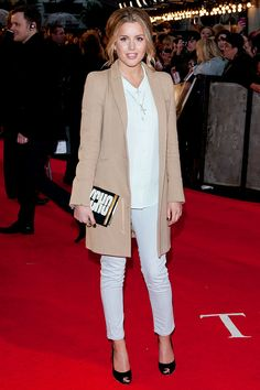 Caggie Dunlop white skinny jeans, camel coat