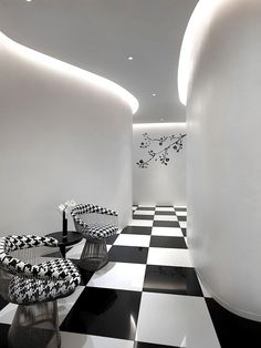 The Club, Singapore.  http://freshome.com/2011/08/16/black-and-white-luxury-hotel-design-the-club-in-singapore/