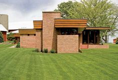 Beautiful exterior brick walls with timber window frames - Frank Lloyd Wright's Muirhead Farmhouse.
