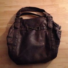 Deena & Ozzy twisted doctor bag urban outfitters This bag is in great condition other than the fact that it's main zipper won't zip shut (an easy fix) I'm getting rid of it because it doesn't go with my style if it was in black id be keeping it! Bags