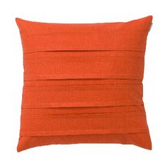 Spira Double Pleat Coral Cushion: Bright coral double pleat cushion, simple but with added interest from the inverted pleats that run horizontally across the front of the cushion.