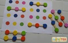 Foam circles & shapes on pop sticks. Match to pattern boards.