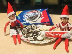 Elf on the shelf. Those naughty little elves are at it again. They brought Double-Stuffed Colgate Oreos and a mischievous grin! Wonder who will take the first bite???