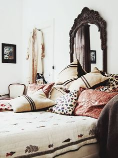 Turkish Influenced Bedroom | Textile Rich, Neutral Palette and Dark Carved Wooden Headboard