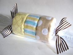 Hey, I found this really awesome Etsy listing at http://www.etsy.com/listing/70844569/blanket-trio-candy-roll