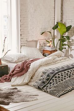 Looking for a laid-back bohemian feel to your bedroom? Think Aztec prints on your duvet cover and matching neutral throws and pillows.