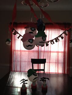 Pirate Mustache Decorations I made for Koen's bday!! All you need is balloons, construction paper (to cut out hats), eye patches (I found these at target), and mustaches (I found these at the dollar store..6 in a pack!). And I put candy inside the balloon so at the end of the party this is what the kids took home :)