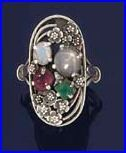 Edith Linnell. Arts and Crafts ring. Silver shaped openwork ring set with various gems and synthetic gems including star sapphire, emerald and synthetic ruby, with flowerhead detail. Part of a group of jewellery by Edith Linnell sold by Bonhams. View 2.