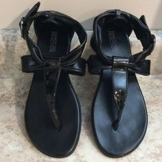Pretty sandals Black patent leather and faux leather straps thong style. Adjustable ankle strap with cute pewter colored nickels. Excellent condition. Nice rubber sole. Kenneth Cole Reaction Shoes Sandals