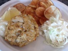 Maryland crab cake with homemade chips and coleslaw