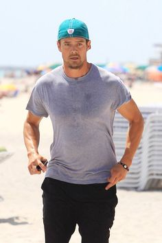 Hunky Josh Duhamel doesn't let the heat stop him from jogging as the actor goes for a run in South Beach, FL wearing a Miami Dolphins cap