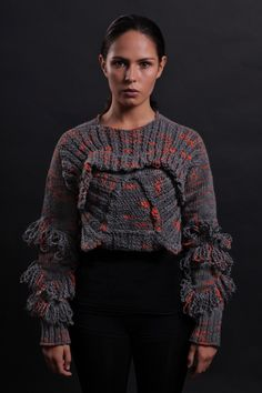 The wildly imaginative fire-breathing hybrid. The Chimera cropped jumper feels soft on the skin, it's warm and super-comfortable which provides a great movement for everyday-wearability. Each panel is separately hand-knitted and hand-finished with an eye-catching sculptural 3D shape at the front p