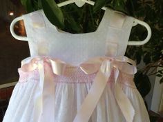 Hanna's Sundress with smocking added to top of skirt. Buttonholes are worked on yokes over the shoulders to accommodate ribbon. Made by Trudy Horne.