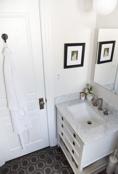 Bathroom with black and brass hex floor tile