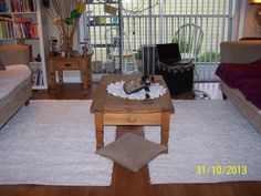 Living room - white fluffy rugs and a cottage-style coffee table. Please, come in!:)