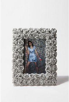 Grey frame.... colors of room - black, grey, sky blue, white