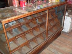 The display cases inside the bakery Bakery Display Case, Display Cases, Display Ideas, Vintage Bakery, Wooden Screen, Pie Safe, Healthy Work Snacks, Video Games For Kids, Store Displays