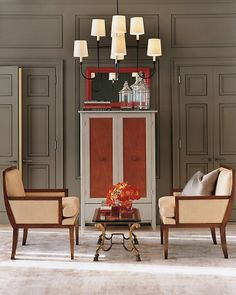 Orange Splash  The shades of autumn such as orange, yellow, dark green, rust and brown make lovely accents for the home. Discover how you can bring the warm and wonderful hues of fall into your rooms.  Muted fabrics and finishes are the perfect canvas for highlighting color. Here, splashes of reddish orange help create a modern feel.