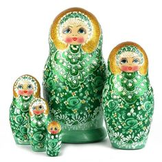 """#Green & Gold #Matryohska - $52.99 Glowing with green, gold, and some white, this wooden nesting doll was wonderfully hand-crafted in Russia. This matryoshka is about 7"""" tall and would make a very unique green accent piece for home decor. All nesting dolls are a joy to own at any age and this green nesting doll is no exception."""