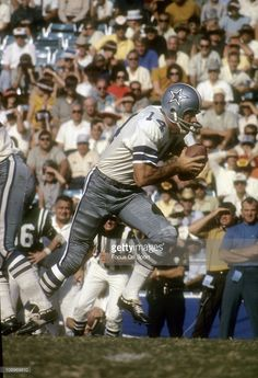 5ab42ad24 Quarterback Craig Morton  14 of the Dallas Cowboys runs with the ball  during an NFL