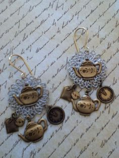 8/23/15 He are my Sunday Earring Challenge.. The tea pot and tea bags, clock, round filigree and jump rings are all from B'sue... made by D. Latre