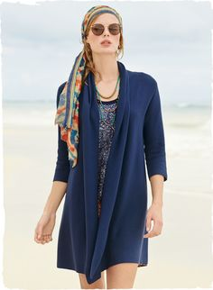 The cardigan is links knit in pima, with shawl collar, buttonless placket and ¾-sleeves.