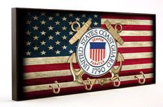 United States Coast Guard Distressed American Flag Key Hanger is found exclusively in our Brotherhoodreg; collection. The bold colors in the design leap off of the wooden surface catching everyones e