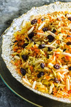 Rosh Hashanah Sweet Basmati Rice with Carrots & Raisins - - Sweet and fragrant basmati rice with carrots and raisins. The perfect vegetarian side dish for any holiday meal. In our house this is a Rosh Hashanah Favorite. Vegan and Gluten Free. Rice Side Dishes, Vegetarian Side Dishes, Food Dishes, Vegetarian Recipes, Kosher Recipes, Honey Recipes, Cooking Recipes, Kosher Food, Low Carb Cupcakes