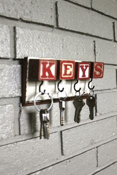 Cute idea for hanging up keys    Could be an easy DIY if you get blocks, screw in mug hooks, screw to a small piece of wood and mount on wall.    Could be cute as monogram too