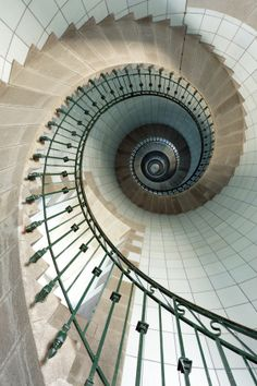 Lighthouse staircase - Dynamic view of high lighthouse staircase, 392 steps, Vierge island, Brittany,France by Stéphane Bidouze