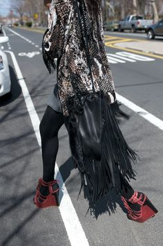 BIRD LADY????   that is some serious fringing on that there bag. awesome.