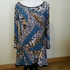 Terrific tunic! Color, pattern, details make this tunic a must-have with your favorite leggings. Black piping on the scoop neckline, the hemline and accenting the long sleeves.  A touch of spandex gives it shape. Made in USA. Tops Tunics