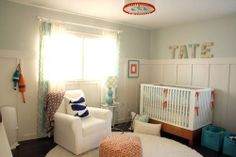 I like the name covered with a map. Wander through our hip orange baby room. Get more decorating ideas at http://www.CreativeBabyBedding.com