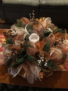 Deco mesh with hurricane and candle centerpiece