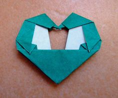 origami penguins in love heart by evi binzinger