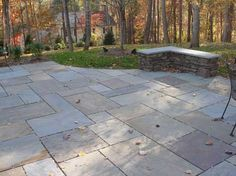 Bluestone patio with seat wall. Stone is dry laid which keeps the cost down. Bluestone is full range color which has various colors running through it for a natural look. Wall is stone and goes well with the patio.