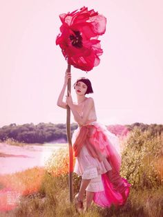 fashion editorial with an awesome jumbo flower. Andressa Fontana by Amanda Pratt for KAREN 12.