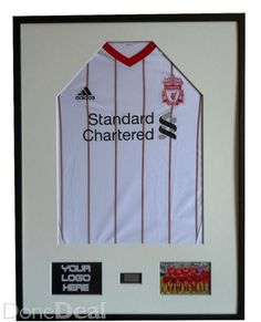 Display Jersey frame Set Black, Exotic Wood FrameDimensions:Frame size: 80 cm x 60 cm.  Picture's size: 10 cm x 15 cm.Place on engraved plate or print : 7cm x 4cm.Black Exotic Wood Frame and Single Mount Board Black or WhiteFits on t-shirts in sizes from S to XLFor Football Jersy or Sport Shirt Display Jersey frameStylish Premium frame consists of acrylic glass, exotic wooden frame, single mount board, board to strech the shirt and backing mdf board with hooks to hang the frameThe luminaire…