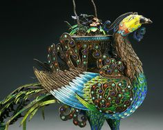 """A Big Chinese Antique Jeweled Filigree Cloisonne Silver Phoenix: with superb detailed filigree artwork, of a well decorated phoenix inlaid with numerous beads of coral, turquoise, jadeite and agate, attached to a wired wood stand with warm brown tone, of Qing Dynasty  Dimensions: L: 19-1/2""""; H: 15-3/4"""""""