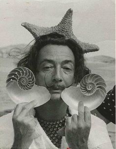 """""""Dali With Shells"""" by Charles Hewitt Spanish surrealist artist Salvador Dali - holds up two seashells at his home in Cadaques on the Costa Brava Spain January (Getty Images) by rachelthebrice L'art Salvador Dali, Salvador Dali Artwork, Jean Arp, Foto Poster, Alberto Giacometti, Rene Magritte, Portraits, Grafik Design, Famous Artists"""