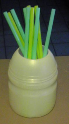 I like reusing Kool Aid and lemonade mix containers to hold everything from straws to ponytail holders to paintbrushes and anything that doesn't need a lid.