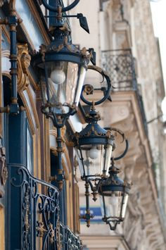 Cast iron lamps and balconies.
