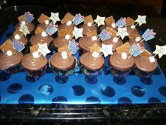 Smore cupcakes with marhmallow creme filling & graham cracker crust!! Family b-day
