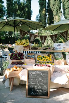 Fruit stand at a summer wedding reception.